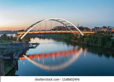 NASHVILLE, TN/USA - AUGUST 7, 2018: Gateway vehicular bridge, also known as the Korean War Veterans Memorial Bridge, carries traffic over the Cumberland River into downtown Nashville, Tennessee.