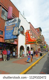 NASHVILLE,TN,USA - SEP 27, 2015: Bars on historical Broadway in downtown Nashville, Tennessee, USA. Lower Broadway is famous for entertainment district of country music.