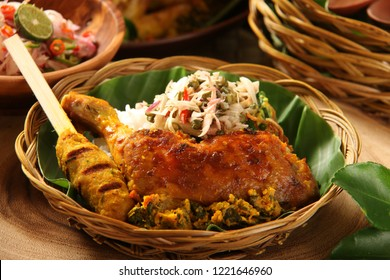 Nasi Campur Ayam Betutu. Balinese roast chicken stuffed with cassava leaves. Accompanied with steamed rice, Sate Lilit, Jukut Antungan, Lawar Nangka and Sambal Matah.