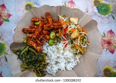 Nasi campur or mixed rice traditional warung food top view