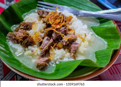 Nasi Gandul or Gandul Rice is a local food from a street food restaurant at Semarang, Central Java. But originated from Pati, Central Java. It's famous with the variety of the beef offal such as Tripe