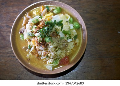 Nasi godog or Boiled rice with slice og kampong chicken and duck egg. delicious food from central java.