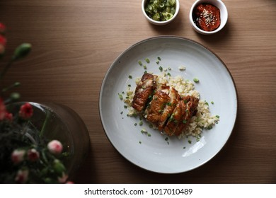 Nasi goreng fried rice with chicken on wood background in top view
