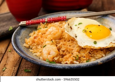 Nasi Goreng -Indonesian Fried Rice served with egg, selective focus
