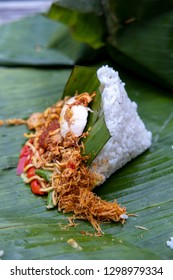 Nasi Jinggo, mixed rice with shredded chicken meat, egg and sambal wrapped with banana leaf. Autenthic balinesse food.