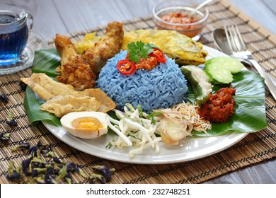 nasi kerabu, blue color rice salad, traditional malaysian cuisine