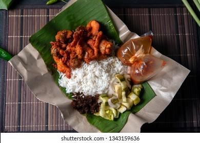 Nasi kukus ayam berempah, popular traditional Malay local food. Flat lay top down overhead view.