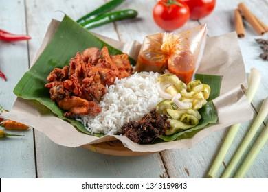 Nasi kukus ayam berempah, popular traditional Malay local food.