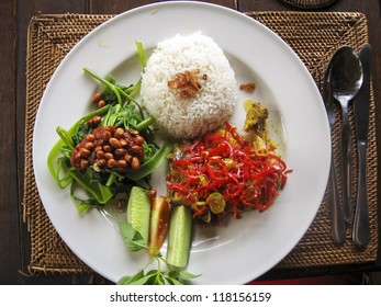 nasi lemack style dish fresh vegetables nuts and fish with rice popular across indonesia and malyasia
