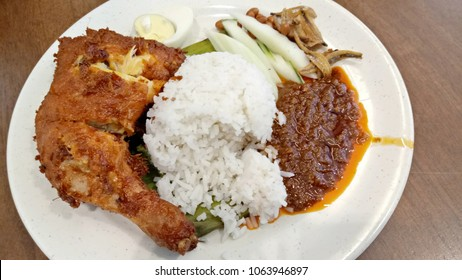 Nasi Lemak with Crispy Fried Chicken on a plate