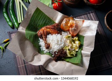 Nasi lemak kukus with chicken, popular traditional Malay local food. Flat lay top down overhead view.