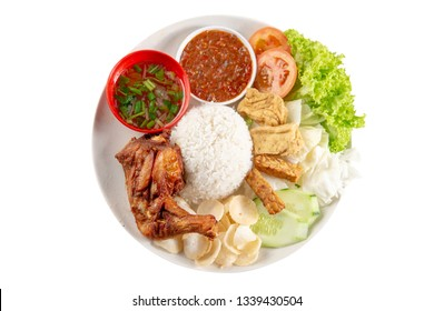 Nasi lemak kukus with fried drumstick, popular traditional Malaysian local food. Isolated on white background. Flat lay top down overhead view.