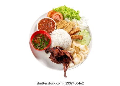 Nasi lemak kukus with quail meat, popular traditional Malaysian local food. Isolated on white background. Flat lay top down overhead view.