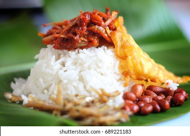 Nasi lemak is a Malay fragrant rice dish cooked in coconut milk and pandan leaf. It is commonly found in Malaysia.