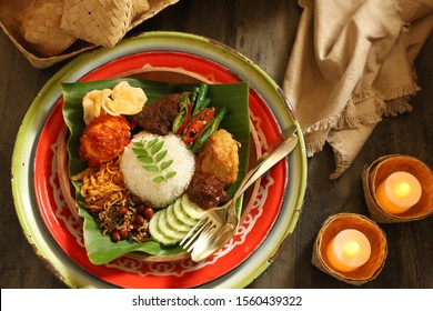 Nasi Lemak Medan. A Malay meal of aromatic seasoned rice with Beef Rendang, Egg in Chili Paste, Potato Stick Crisp, Peanuts and Anchovies, Potato Patty, Long Beans, Cucumber, Chili Paste and Crackers.