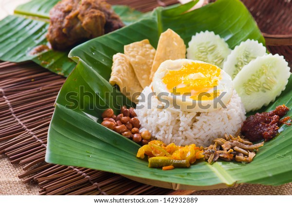 nasi lemak, a traditional malay curry paste rice dish served on a banana leaf