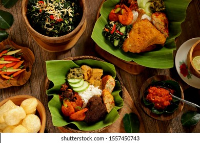 Nasi Padang. Popular Minang meals of rice with Beef Rendang and Jackfruit Curry while the other with Chicken Curry and Cassava Leaves. Both have Chili Shrimps, Omelette and Green Chili Paste.