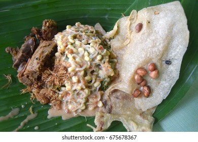 Nasi pecel is a Javanese rice dish served with mix vegetables and peanut sauce