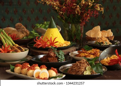 Nasi Tumpeng Nusantara. The elaborate Indonesian rijsttafel of yellow rice with seven side dishes from several regional cuisines in the country.