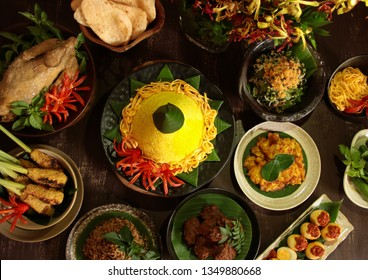 Nasi Tumpeng Nusantara. The elaborate Indonesian rijsttafel of yellow yice with seven side dishes from several regional cuisines in the country.