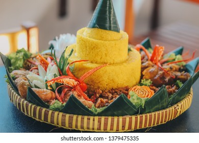 Nasi Tumpeng Nusantara, Java traditional food. The elaborate Indonesian rijsttafel of yellow rice with side dishes from several regional cuisines in the country for Independence  celebration.
