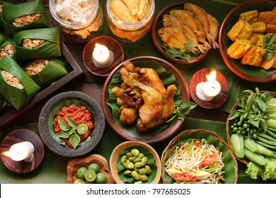 Nasi Tutug Oncom. Traditional Sundanese meal of rice mixed with fermented soybean; accompanied with fried chicken, tempeh, tofu, salted fish, vegetables dishes, chili paste and crackers.