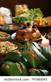 Nasi Tutug Oncom. Traditional Sundanese meal of rice mixed with fermented soybean; accompanied with fried chicken, tempeh, tofu, vegetables dishes, chili paste and crackers.
