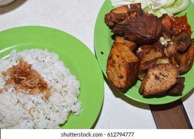 nasi uduk with a side dish of fried chicken and fried tofu, Indonesian traditional food, which is rice boiled in coconut milk