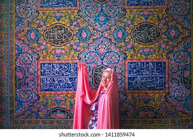 Nasir al-Mulk Mosque, Shiraz/iran-April 28, 2019: woman is visiting and posing at the mosque with dazzling stained glass, thousands of painted tiles on the ceiling in Shiraz, Iran
