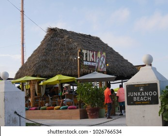 NASSAU, BAHAMAS—JANUARY 2018: One of the popular tiki bars with thatched roofing at Junkanoo Beach or Long Wharf in Nassau, Bahamas.