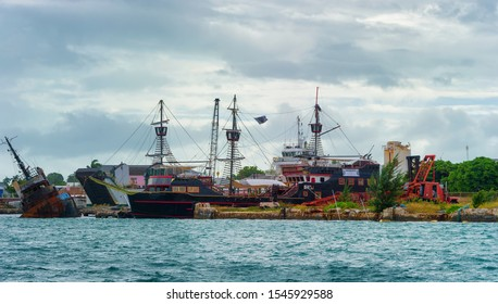 Nassau, Bahama - September 21,2019:  Old Schooners decked out like pirate ships draw tourist near Prince George Wharf on New Providence Island.