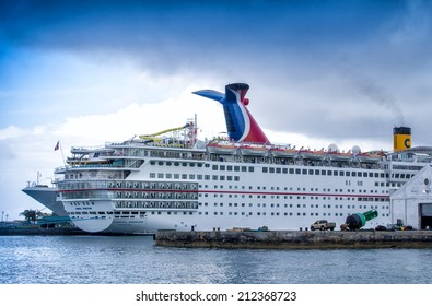 NASSAU, BAHAMAS - CIRCA FEBRUARY, 2012: Cruise ships docked at the Bahamas port of call. Most cruise lines include the islands of the Bahamas as a destination point on their itineraries