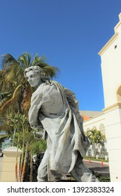 Nassau, Bahamas Dec. 12, 2018–Statue of Governor Woodes Rogers at British Colonial Hotel with slogan Pirates Expelled, Commerce Restored.In 1718 Rogers publicly hung pirates to restore safe seafaring.