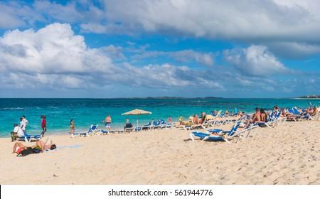 NASSAU, BAHAMAS - DECEMBER 20: People relaxing on the beautiful beach in Nassau, Bahamas on Dec 20, 2016.