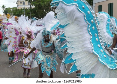 Nassau, Bahamas - December 26, 2018: Bahamian partygoers participate in the Junkanoo Festival by dressing up and marching with floats.