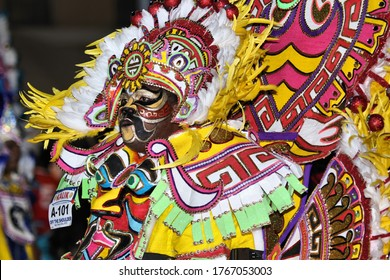 Nassau, The Bahamas- December 26 2019 - Boxing Day Junkanoo Parade Celebration held in downtown Nassau at 2 am in the morning. Participants dressed in colorful costumes while dancing in the streets.