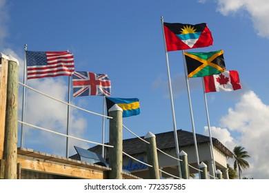 NASSAU, BAHAMAS - DECEMBER 4, 2017: Flags of Antigua and Barbuda, Canada, Jamaica, United States, United Kingdom and Bahamas at the Sandals Royal Bahamian resort in Nassau, Bahamas
