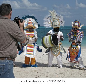 NASSAU, BAHAMAS - FEBRUARY 20:  Photographing costumed Junkanoo dancers and drummer on the beach in Nassau, Bahamas on February 20, 2011.