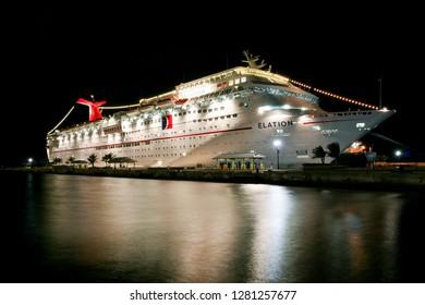 Nassau / Bahamas - February 7.2007:  View on the illuminated white carnival cruise ship at night docked by the pier.