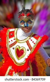 NASSAU, BAHAMAS - JAN 1-  unidentified Young girl in festive costume dances in Junkanoo, a traditional Bahamian Carnival Parade on Jan 1 in Nassau, Bahamas.