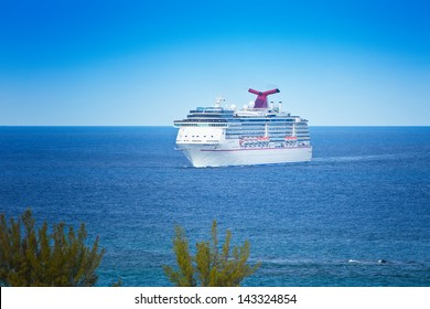 NASSAU, BAHAMAS - JAN.13:  The Carnival Miracle approaches the port of Nassau on Jan. 13, 2013.  Carnival Cruise Lines frequents the Bahamas as it's one of the world's most famous travel destination.
