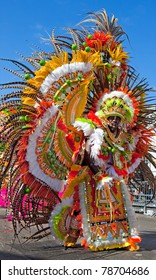 NASSAU, THE BAHAMAS - JANUARY 1 - Dancing man in yellow and orange feathered costume, performs in Junkanoo, a traditional island cultural festival in Nassau, Jan 1, 2011