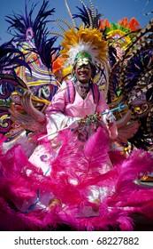 NASSAU, THE BAHAMAS - JANUARY 1 - Female troop leader dances in Junkanoo, a cultural festival on Jan 1, 2011 in Nassau