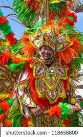 NASSAU, BAHAMAS - JANUARY 1: Joyous but tired dancer from Bahamas Junkanoo depicts Birds of a Feather in Nassau, Jan. 1, 2011