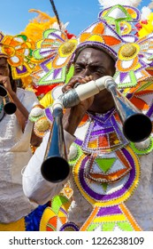 NASSAU, THE BAHAMAS - JANUARY 1 - Musician carrying lair horns, performs in Junkanoo, a traditional island cultural festival in Nassau, Jan 1, 2011..CR2