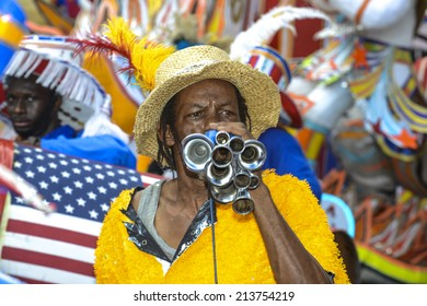 NASSAU, THE BAHAMAS - JANUARY 1: Musician in traditional costume at Junkanoo Festival on January 1st 2014 in Nassau, the Bahamas