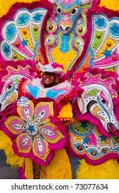 NASSAU, THE BAHAMAS - JANUARY 1 - Smiling, dancing woman performs in Junkanoo, a traditional island cultural festival in Nassau, Jan 1, 2011