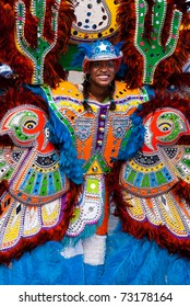 NASSAU, THE BAHAMAS - JANUARY 1 - Smiling, dancing woman in blue feathered costume, performs in Junkanoo, a traditional island cultural festival in Nassau, Jan 1, 2011