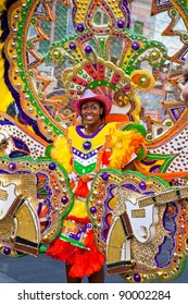 NASSAU, THE BAHAMAS - JANUARY 1 - Smiling, dancing troop leader in brightly colored costume, performs in Junkanoo, a traditional island cultural festival in Nassau, The Bahamas on Jan 1, 2011