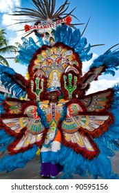 NASSAU, THE BAHAMAS - JANUARY 1 - Smiling, dancing troop leader in brightly colored costume, performs in Junkanoo, a traditional island cultural festival in Nassau, Jan 1, 2011